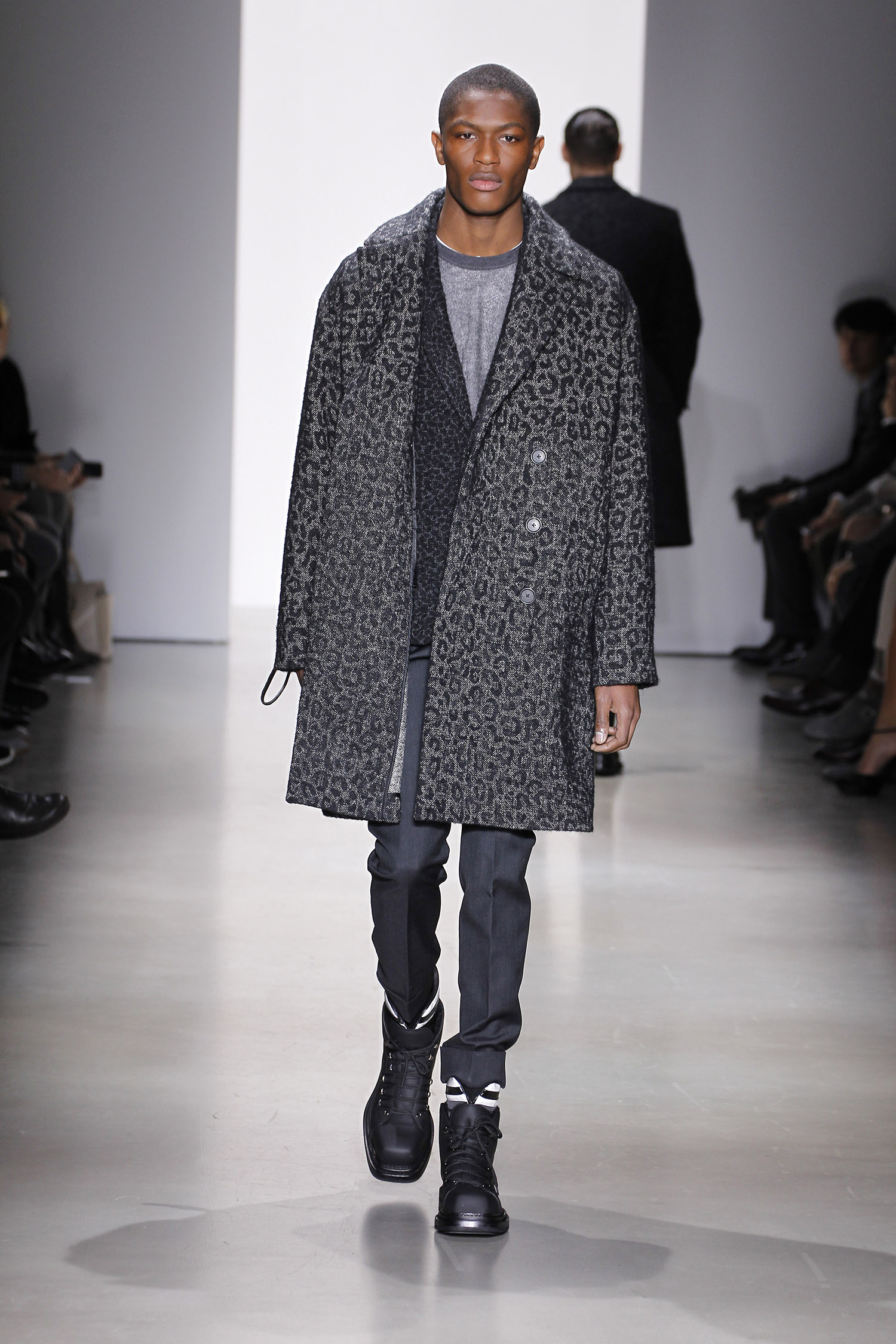 a023358c08166e Smooth calf and patent leather field boots complemented the overall feeling  of rugged utilitarianism.